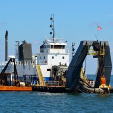 Oil pays not fines but dredging does?