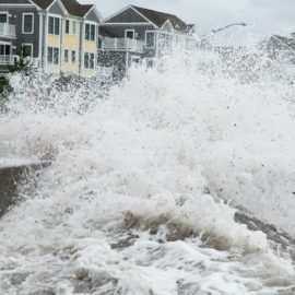 Waves overflowing the sea wall